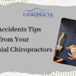 car accident centennial chiropractors man holding vertebrae dr. darby campbell